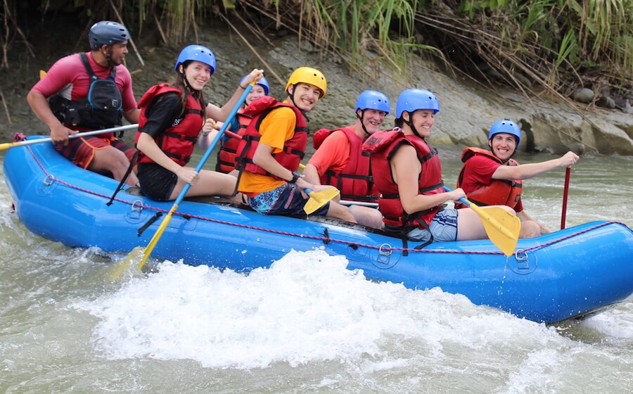 group of teenagers whitewater rafting in Costa Rica